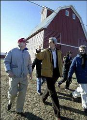 Sen. John Kerry, D-Mass., talks with retired farmers Richard, left, and Mary C. Baumhover near Carroll, Iowa. Kerry, a candidate for the Democratic presidential nomination, flew by helicopter to several events Thursday in western Iowa.