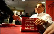 """Pete Rose signs copies of his new book, """"Pete Rose: My Prison Without Bars,"""" in New York. In the book, Rose repeatedly challenges the report on his gambling by John Dowd and the accusations made by his former associates before he accepted a lifetime ban in August 1989."""