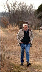 Wes Jackson, founder of the Land Institute, walks on institute ground near Salina. Jackson is working to develop agriculture procedures that more closely mimic the prairie's natural workings.