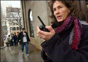 Deborah Bleau, 44, of Latham, N.Y., uses a walkie talkie to communicate with her daughter in Boston. An annual Massachusetts Institute of Technology survey found that many adults said they couldn't live without their pesky cell phones.