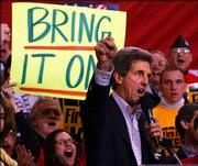 Democratic presidential hopeful John Kerry yells to supporters after his arrival in Manchester, N.H. The candidates hit the campaign trail Tuesday in New Hampshire, strategizing how to get ahead after unpredictable results in the Iowa caucuses. Kerry came in first place.