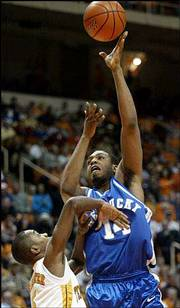 Kentucky's Eric Daniels (14) shoots over Tennessee's John Winchester. Kentucky won, 69-68, in overtime Tuesday at Knoxville, Tenn.