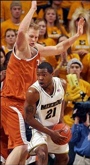 Missouri's Randy Pulley, right, looks for help while guarded by Jason Klotz of Texas. The Longhorns won, 75-69, in overtime Tuesday at Columbia, Mo.