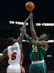 Boston's Paul Pierce, right, scores over Miami's Eddie Jones in the first quarter of Tuesday's game. Pierce, a former Kansas University standout, scored 29 points in Boston's 86-84 victory in Florida. It snapped the Celts' four-game skid.