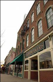 A proposal to create a downtown historic district would also place restrictions on any property within 500 feet of the district. Any activity that requires a building permit within the district is subject to review by the city's seven-member Historic Resources Commission.