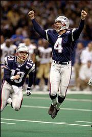 New England kicker Adam Vinatieri celebrates his 48-yard game-winning field goal in the final seconds of Super Bowl XXXVI. The kick lifted the Pats over the Rams in the game Feb. 3, 2002, in New Orleans.