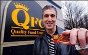 Brian Weinstein, 49, displays his preferred customer discount card in front of a QFC grocery story in Mercer Island, Wash. During the recent beef recall related to a Washington case of mad cow disease, the regional grocery chain used its discount cards to advise concerned shoppers whether they might have purchased meat from the infected cow. QFC posted a small notice in its meat departments letting cardholders know they could find out whether they'd bought any of the beef recalled by the U.S. Department of Agriculture. Weinstein bought recalled beef and served it to his family.