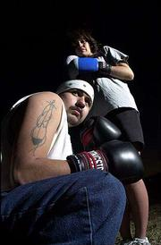 Wambli Doleza, left, a freshman from Crow Creek, S.D., and a member of the Sioux tribe, and Kara Tso, a sophomore from St. Michaels, Ariz., and member of the Navajo tribe, are participants in the Haskell Boxing Club. The student-run organization, despite being without a ring or punching bags and with just limited access to a gym, is growing in popularity on the Haskell Indian Nations University campus.