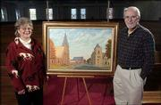 Judy and Dennis Dailey have given an oil painting to First United Methodist Church. The painting shows the church, Trinity Episcopal and Plymouth Congregational from a view looking north down Vermont Street.