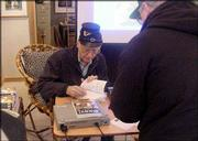 """Lawrence author Tom Mach signs copies of his first novel, """"Sissy!"""" at Framewoods Gallery in Topeka. The book blends historical fact and fiction to tell the story of a young Lawrence woman who disguises herself as a man to fight for the Union army during the Civil War."""