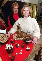 The Baldwin Community Arts Council will take bids on sweets, art and services during its 16th annual Chocolate Auction Feb. 8. Among the artists/bakers donating chocolate creations are Laura Morford, left, who carved two chocolate baskets filled with chocolate-dipped pecans and strawberries, and Karen Bayer, who spent 12 hours sculpting a three-pound chocolate tree.