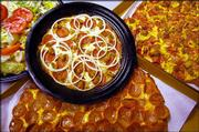 "Donatos Pizzeria, based in Columbus, Ohio, has announced it will roll out a pizza with a low-carb crust in its 182 outlets. Spokesman Tom Santor said the pizza dough, made out of soy protein and other ingredients, ""tastes fabulous."""