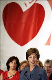 """First lady Laura Bush speaks during a visit to Baptist Hospital of Miami as part of """"Heart Awareness Month,"""" to promote awareness of heart disease in women. Bush spoke Wednesday, two days after kicking off the health campaign at the White House calling on Americans, especially women, to learn more about heart disease and ways to prevent it."""