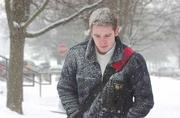 Alan Kilday, 20, a Kansas University junior from Scotland, felt just like home Thursday morning as the snow covered his coat and head while he walked to classes.