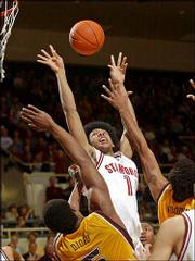 Stanford guard Josh Childress grabs a rebound in front of Arizona State forward Ike Diogu, lower left, and forward Keith Wooden, right, a former Free State High standout. The second-ranked Cardinal remained undefeated with an easy 81-51 win Thursday in Stanford, Calif.