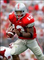 Ohio State tailback Maurice Clarett runs for a touchdown in this 2002 file photo. Clarett was ruled eligible for the NFL draft Thursday by a federal judge who concluded an NFL rule barring eligibility violated antitrust laws.