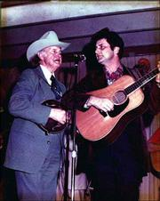 James Monroe, right, shares a stage with his legendary father Bill Monroe, circa the 1970s.