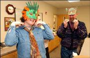 From left, Paula McMatton, Sidney Hardgrave and Tony Peterson try on masks for Mardi Gras on the Kaw. The second annual fund-raiser for Independence Inc. is scheduled for Valentine's Day and will include cajun food, music, wine and, of course, beads and masks.