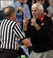 Texas Tech coach Bob Knight, right, pleads his case for a one-and-one free-throw opportunity for the Red Raiders.