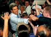 Democratic presidential hopeful U.S. Sen. John Kerry, D-Mass., shakes hands as he reaches into a crowd of supporters during a rally in Richmond, Va. Kerry was campaigning Saturday in the South while caucus-goers in Washington and Michigan were giving him a crushing victory over his Democratic rivals.
