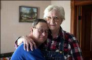 Gary, 57, and Dorothy Rumbaugh, 85, share a hug in their McLouth living room. Dorothy has cared for her son all of his life.