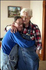 Gary, with his mother, Dorothy, is fond of using the universal sign of affection: a hug.