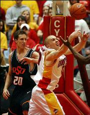 Iowa State's Jake Sullivan, right, tries to grab a rebound in front of Oklahoma State's Daniel Bobik. The 13th-ranked Cowboys beat the Cyclones, 88-67, Saturday in hostile Hilton Coliseum in Ames, Iowa.