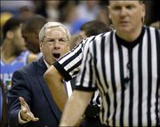 North Carolina coach Roy Williams shouts at a referee during the