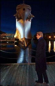 Democratic presidential hopeful Sen. John Kerry, D-Mass., stops to look at the decommissioned U.S.S. Wisconsin battleship in Norfolk, Va. Kerry was in Virginia on Sunday, already campaigning to claim primary victories in the South this week.