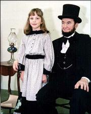 "Bud Green, Versailes, Mo., 78, won the Abraham Lincoln look-alike contest in Lincoln, Ks in 1994. With him is Hanna Nielsen portraying Grace Bedell, the Westfield, New York youngster who wrote to presidential candidate Abe Lincoln suggesting he grow a beard for his campaign. The real Grace Bedell later moved to Delphos where she died in 1938. Copies of her correspondence are currently on display in her great-grandson&squot;s restruant ""The Scheme"" in Salina."