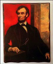 A decoupage on pressed beveled wood of Abraham Lincoln is part of the Lincoln Collection at the University of Saint Mary De Paul Library in Leavenworth. The art work, shown in February 1999, is among 10,000 items in the special collection about the 16th president. The library is open seven days a week.