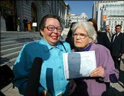 Phyllis Lyon, left, 79, and Del Martin, 83, both of San Francisco and a couple for 51 years, hold up their marriage certificate outside City Hall after they were married in a civil ceremony in San Francisco. In a political challenge to California law, city authorities officiated at 87 gay marriage ceremonies and issued 95 marriage licenses Thursday.