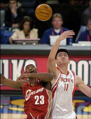 Cleveland's LeBron James, left, of the Rookies battle Houston's Yao Ming of the Sophomores. The sophomore squad won the Rookie Challenge, 142-118, Friday night in Los Angeles.