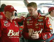 Dale Earnhardt Jr., right, chats with crew chief Tony Eury Sr. after practice. Earnhardt, shown Tuesday, is a favorite to win today's NASCAR season-opening Daytona 500 in Daytona Beach, Fla.