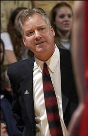 "Nebraska head coach Barry Collier argues a call during a game against Kansas University in this file photo. Collier, whose Huskers are 13-7 this season, believes ""great things can happen"" for Nebraska men&squot;s basketball."