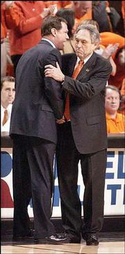 Kansas University men's basketball coach Bill Self, left, shakes hands with Oklahoma State coach Eddie Sutton after the Cowboys' 80-60 win over KU Monday in Stillwater, Okla.