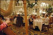 A group of visitors sit for afternoon tea in The Plaza Hotel's Palm Court in New York. The Plaza is the city's only hotel designated a National Historic Landmark, and as guests pass the limos parked outside, they're walking in the footsteps of Vanderbilts and movie stars.
