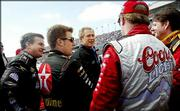 """President Bush, center, meets with NASCAR drivers, from left to right, Joe Nemechek, Jaime McMurray, Sterling Marlin and Johnny Benson before the start of the Daytona 500 NASCAR race. The """"NASCAR dad"""" demographic is highly coveted among this year's presidential candidates."""