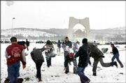 Syrians play in the snow piled up in Damascus and other hilltop areas. A rare snowstorm hit the Mideast this weekend, with more than 2 1/2 feet of snow reported in some areas.