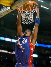 Paul Pierce dunks during the NBA All-Star Game. Pierce, a former Kansas University standout, scored eight points for the Eastern Conference during Sunday's game at Los Angeles. The Western Conference won, 136-132.
