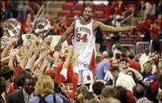 North Carolina State's Marcus Melvin (54) celebrates with fans as he stands on the scorers' table. Melvin scored 18 points in the 21st-ranked Wolfpack's 78-74 victory over top-ranked Duke on Sunday in Raleigh, N.C.
