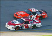 Dale Earnhardt Jr. (8) passes passes Tony Stewart on lap 181. Junior went on to win his first Daytona 500 title Sunday.