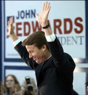 U.S. Sen. John Edwards acknowledges the crowd after being introduced at the University of Wisconsin at Eau Claire. Edwards was on a four-city swing through Wisconsin on Monday, a day before the state's presidential primary.