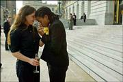Same-sex couple Janet Thomson, left, and Jamye Ford, both of San Francisco, celebrate outside City Hall after being married in San Francisco. The city of San Francisco, which has sanctioned more than 2,800 gay marriages in the past week, sued the state of California on Thursday, challenging its prohibitions on same-sex marriages on constitutional grounds.