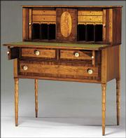 This Federal desk was made in Massachusetts about 1810 from maple and mahogany. It sold for $9,000.