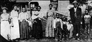 The George Washington Family in 1902 stands outside their home in Bloomington. George is second from right.
