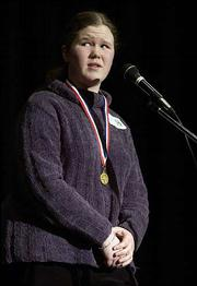 "Laura Drees, 14, a West Junior High School eighth-grader, waits to hear if she spelled her final word correctly in the Douglas County spelling bee at Southwest Junior High. Drees won Saturday by spelling ""ridiculously"" and then ""effluent"" to win her first Douglas County Spelling Bee."