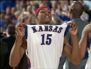 J.R. Giddens, the Jayhawks' scoring leader with 24 points, holds his head and his jersey high following KU's win over Iowa State.