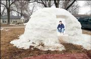 Jason Botz, Lawrence, constructed an igloo recently while waiting for his wife to give birth to their third child.