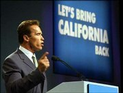 Calif. Gov. Arnold Schwarzenegger, a Republican, presents a 10-point plan he said he would implement during his first 100 days as governor in this Oct. 1, 2003, file photo. With his term already 100 days old, much of the governor's legislative agenda remains mired in the Legislature.